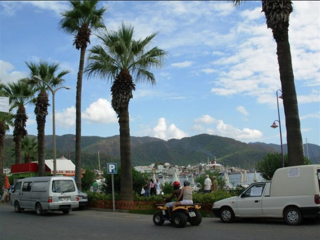 tourists in marmaris and hills across